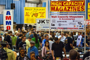 Signs at a 2011 Florida gun show advertise high-capacity magazines and accessories.