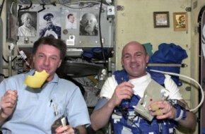 European Space Agency astronaut Andre Kuipers (R) and his NASA colleague Michael Foale eat Dutch cheese for breakfast on the International Space Station.