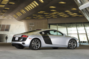 The Audi R8's side blades are swaths of carbon fiber that run directly behind the passenger doors.