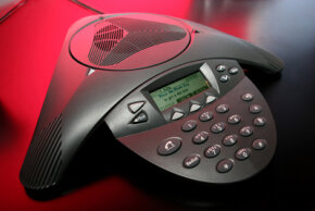 Options on phones allow you to adjust volume and manage participants during conference calls.