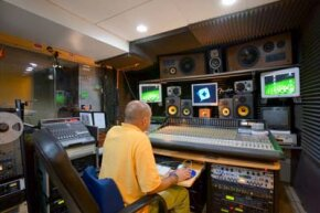 Sound engineers combine a film's dialogue and sound effects in a post-production studio.