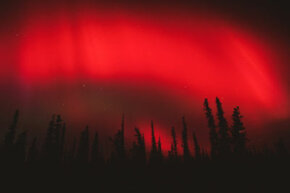 Red aurora borealis over Wrangell/St.Elias National Park in Alaska
