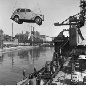 A car is loaded onto an English ship for export. This type of auto transport works well for foreign and exotic cars.