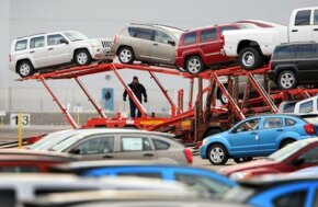 Workers load Chrysler vehicles for transport in Illinois. See more pictures of trucks.
