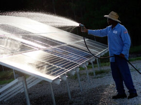 Kindrell Hutchinson of the Leveda Brown Environmental Park and Transfer Station does things the old-fashioned way -- a light rinse with a hose.