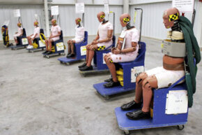 Crash test dummies sit on display at General Motors' new $10 million crash testing center in Milford, Mich. GM announced that rollover air bags will be standard equipment in all its vehicles by 2012.