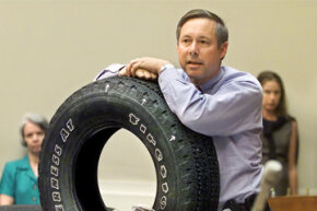 Rep. Fred Upton, R-Mich., displays a Firestone Wilderness AT model tire during a House Commerce Committee hearing on Capitol Hill, on June 19, 2001, looking into Ford Motor Company's recall of Firestone tires.