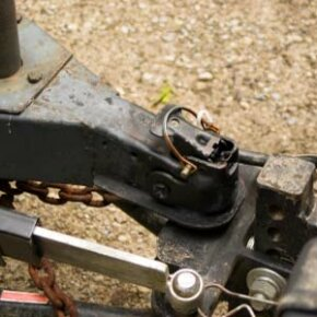 You can connect vehicles together using devices like this towing hitch. See pictures of trucks.