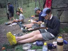 Appalachian Trail hikers prepare and eat dinner in the Great Smokey Mountains.