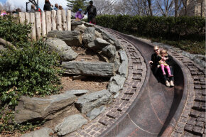 The granite slide at Billy Johnson Playground in Central Park gets a thumbs-up. Kids in the know bring a piece of cardboard to help them whiz down even faster.