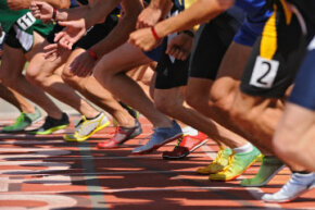 Although the shoes worn by pro runners aren't advertised as barefoot running shoes, most of them have the flat sole vital to a good minimalist shoe.