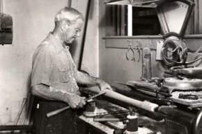 "John Andrew ""Bud"" Hillerich, creator of the ""Louisville Slugger,"" makes a bat in the Louisville, Ky. factory circa 1930's."