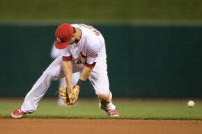 Daniel Descalso of the St. Louis Cardinals makes an error on a ground ball in the eighth inning in a game against the Cincinnati Reds. See more sports pictures.