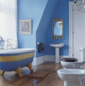 The ornately embellished tub gleams in this otherwise low-key bathroom.