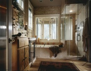 Natural stonework transforms this bath into an opulent, cavernous retreat.