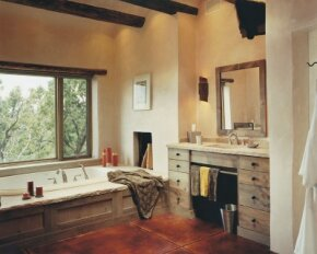 Even with rough-hewn materials, this ranch-style bathroom projects an image of elegance.