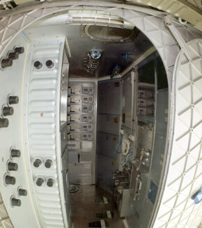 A wide-angle view of the Orbital Workshop waste management compartment. The actual toilet's down the hall, to your right. See more astronaut pictures.