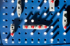 Part of the bottom half of a Battleship board, with one ship already sunk.