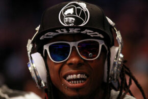 Hip-hop artist Lil' Wayne, wearing diamond studded Beats headphones by Dr. Dre courtside during the 2012 NBA All-Star Game