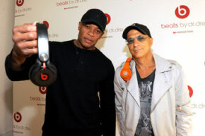 Dr. Dre and Jimmy Iovine show off their Beats headphones.