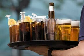 Why does a head of foam rapidly disappear on soda but stay in place on beer?