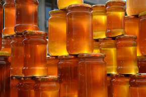 Various kinds of honey are displayed at a honey and beekeeping products fair in Bucharest, Romania April 4, 2014. Bee venom is used to combat multiple sclerosis, pollen for indigestion, and honey to heal wounds.