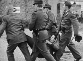 West German police arrest a young man, one of the angry crowd throwing stones at a bus full of Soviet guards making their way to the Soviet War Memorial, Aug. 20, 1962.