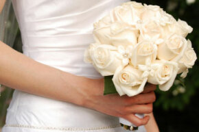 White roses symbolize purity and young love, which makes them a perfect choice for bridal bouquets.