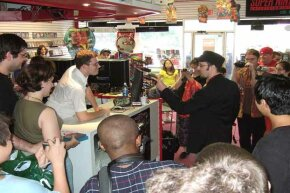 Doug Walker (right), as his alter ego Nostalgia Critic, takes on James Rolfe (the Angry Video Game Nerd) at a video game store in New Jersey.