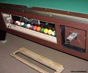 The ball return in a commercial billiard table