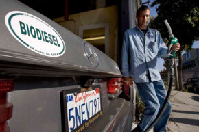 A diesel car owner fills up his tank with biodiesel fuel at the Biofuel Oasis station in Berkeley, Calif.
