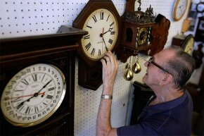 Howard Brown adjusts the time on a clock he just repaired. Brown can adjust all the clocks in his clock shop easily to conform to daylight saving time, but our body clocks don't adjust so well.