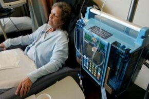 A breast cancer patient receives a trial medication treatment in the infusion center at the UCSF Comprehensive Cancer Center in San Francisco.