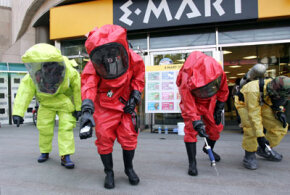 Emergency services in chemical protection clothing participate in an anti-chemical and biochemical terror exercise on May 21, 2007 in Seoul, South Korea.
