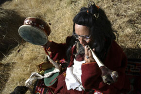 A burial master blows a horn made of human bone to pray for the dead during a sky burial ceremony at the Chanlang Temple on Nov. 1, 2007.