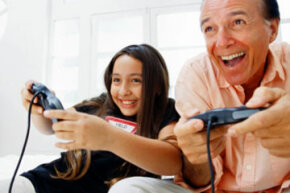 Image Gallery: Parenting Technology doesn't have to be isolating. Gaming with your kid is a guaranteed good time! See more parenting pictures.