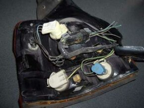 This is the tail light assembly from a 1993 Saturn. The cut wire ends would lead to the main wiring harness inside the car if this assembly were still attached.