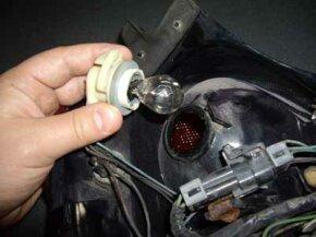 The brake light socket with the bulb.