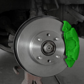 The brake pads are housed in a car's brake system.