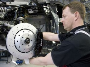 A lot of high-performance brake rotors are drilled, like these rotors, on the Audi R8.