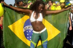 A Brazilian woman celebrates the country's 2002 World Cup win. Brazil has won the international soccer competition five times since it began in 1930.