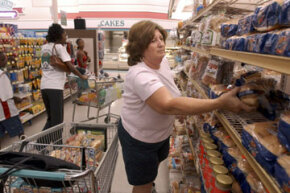 Shoppers stock up on bread before Hurrican Katrina.  What is it about human nature that makes us reach for bread and milk before storms hit?