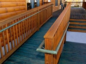 Wheelchair ramps can be made of many materials, including wood. While wood is relatively inexpensive at the outset, it can be more expensive later due to maintenance costs.