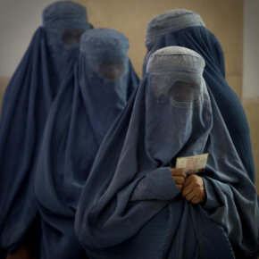 Women wearing burquas wait to cast their votes in the 2009 presidential election in Afghanistan.