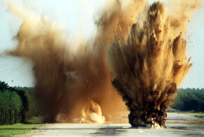Soldiers set off two C-4 charges on an air base runway during a training operation. Like other high explosives, C-4's destructive power comes from rapidly expanding hot gas.