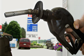 A customer prepares to fill his car with gas at a station in Zelienople. Pa.