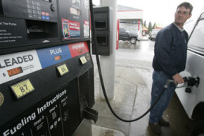 A customer fills up his car at a Speedway gas station in Columbus, Ohio.