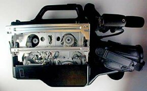 A camcorder with the VCR unit exposed