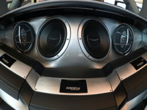 Your car may not need three amplifiers like this car has, but adding an amp might improve your system's output.