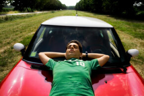 This guy's over the moon about his Mini. Are his insurance rates astronomical, too? See pictures of small cars.
